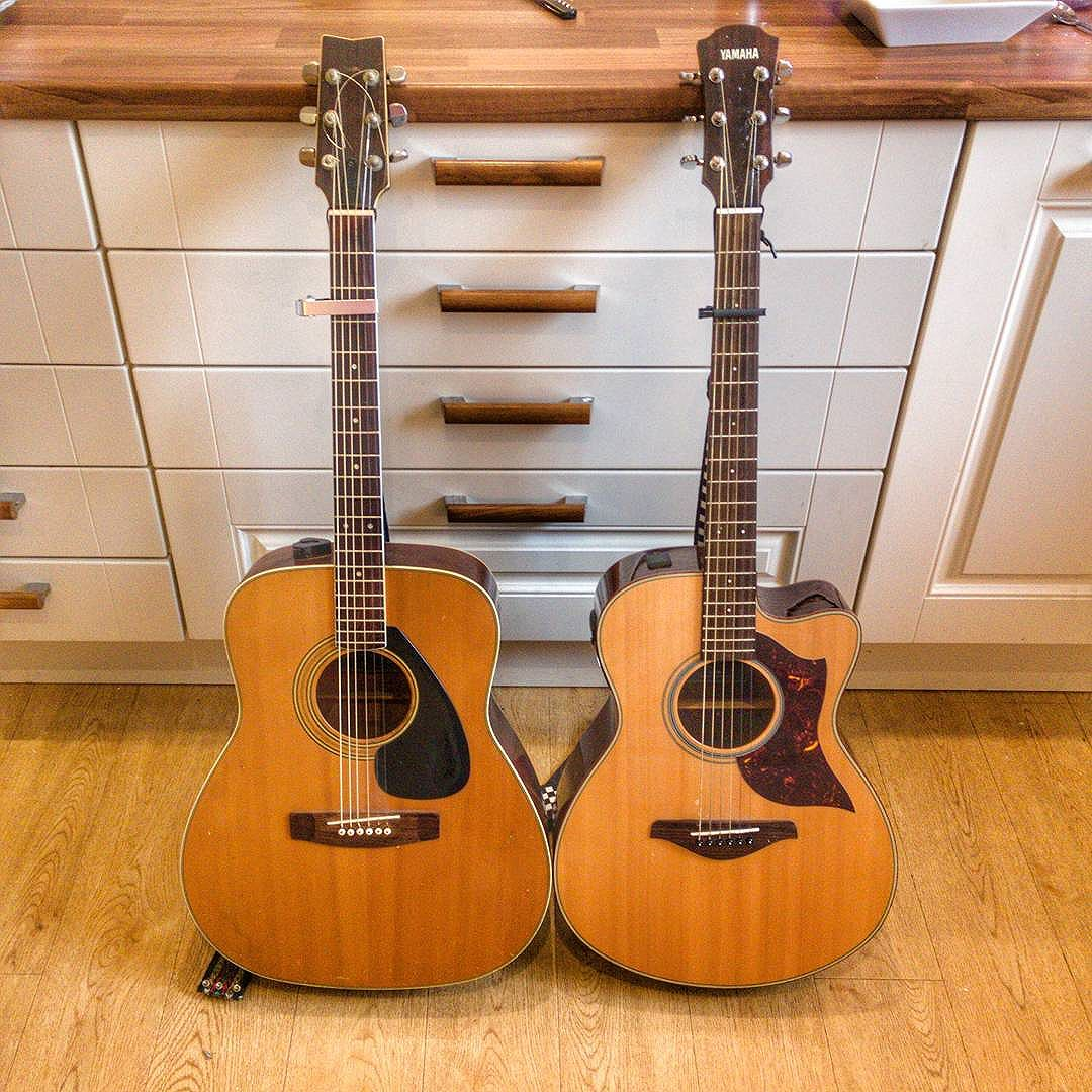 My Dad's guitar next to my guitar.