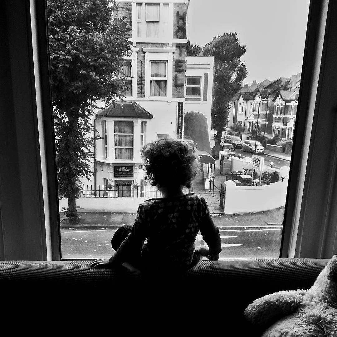 Almost every morning she loves to sit on top of the sofa and wave to the busses as they pass (and sometimes other Actonians).